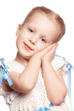 Tender. Girl holding her hands to her cheek Royalty Free Stock Photos