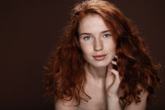 Tender attractive redhead woman posing for studio shot Royalty Free Stock Image