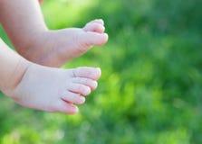 Tender baby feet  at iytsude Royalty Free Stock Photo
