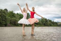 Ballerinas posing in river stock photo