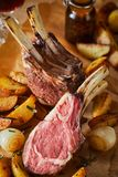 Tender barbecued rack of lamb with vegetables royalty free stock photo