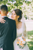 Tender beautiful bride looking over the shoulder of the groom Royalty Free Stock Images