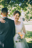 Tender beautiful bride looking over the shoulder of the groom Royalty Free Stock Photo