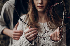 Tender beautiful hipster woman in white sweater holding black be. Rry branch, hands closeup Stock Image