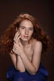Tender beautiful redhead woman posing for studio shot Royalty Free Stock Photography