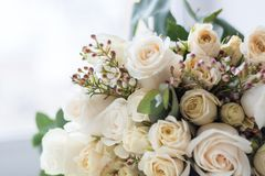 Tender beautiful wedding bouquet closeup, peach color roses and decoration, selective focus.  royalty free stock photo