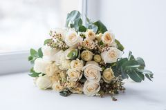 Tender beautiful wedding bouquet closeup, peach color roses and decoration, selective focus.  stock photography