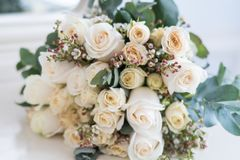 Tender beautiful wedding bouquet closeup, peach color roses and decoration, selective focus.  stock image