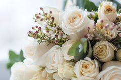 Tender beautiful wedding bouquet closeup, peach color roses and decoration, selective focus.  royalty free stock photos