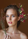 Tender beauty portrait of bride with roses wreath in hair. Royalty Free Stock Photography