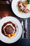 Tender beef Filet mignon steak with brawn gravy sauce. Top view. Delicious tender beef Filet mignon steak with red wine gravy sauce in white plate. Top view shot stock image