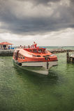 Tender boat on the carribbean beach. St. Thomas resort, tender boat getting to the port to take off passengers Stock Photo
