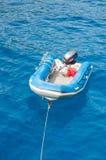 Tender boat in a sea Stock Photo