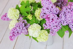 A tender bouquet of lilac and buldenezh Stock Photos