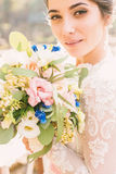 Tender bride with beautiful bouquet Royalty Free Stock Images