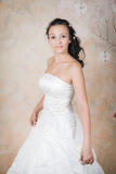 Tender bride in an elegant white dress Stock Photography