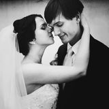 Tender bride holds groom's head with love Royalty Free Stock Images