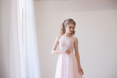 Tender bride in a white room before the wedding royalty free stock photo