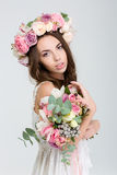 Tender charming bride in rose wreath with bouquet of flowers Royalty Free Stock Photos