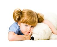 Tender child. Portrait of lying tender child with teddy bear stock photos