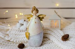 Tender christmas angel figurine with christmas lights Royalty Free Stock Photos