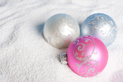 Tender Christmas bauble on to snow. Stock Images