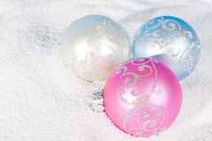 Tender Christmas bauble on to snow. Stock Image