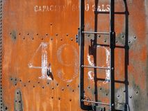 Rusted Locomotive Tender Car. A tender or coal-car is a special rail vehicle hauled by a steam locomotive containing its fuel wood, coal, or oil and water. Steam Stock Images