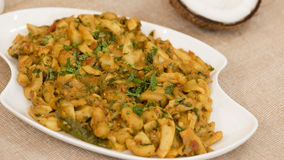 Tender coconut and cashew sukke is a vegetarian dish from Goa, India Stock Photos