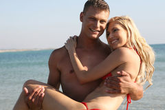 Tender couple on the beach Royalty Free Stock Image
