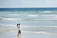 Tender couple on the beach of Sperlonga, Italy Royalty Free Stock Image
