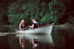 Tender couple boating on river Royalty Free Stock Image