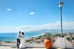 Tender couple bride and groom in wedding day in Sperlonga, Itay. Europe Stock Image