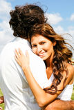 Tender couple hugging. Young lady smiling and hugging looking at camera Stock Images