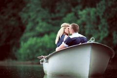 Tender couple hugging on the boat Stock Image
