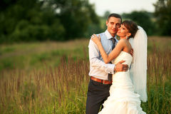 Tender couple is hugging in the herbs on the background forest Stock Photos