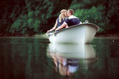 Tender couple kissing on the boat royalty free stock images