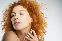 Tender curly haired girl wearing light perfume