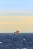 Tender Drilling Oil Rig In The Ocean. For Petroleum Development Royalty Free Stock Photo
