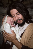 Tender father in nativity scene Royalty Free Stock Image