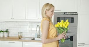 Tender female holding bouquet stock footage