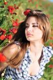 Tender girl in field of poppy Stock Photography