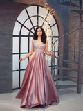Tender gorgeous graceful lady at vintage stairs, girl in long gorgeous pink tender dress with sparkles, attractive. Beauty with dark brunette hair, nice image stock photography