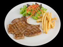 Tender grilled porterhouse or t-bone steak served with golden Fr Royalty Free Stock Photos