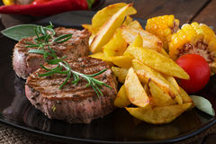 Tender and juicy veal steak. Medium rare with French fries Stock Photography