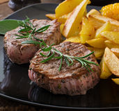 Tender and juicy veal steak. Medium rare with French fries Royalty Free Stock Photos