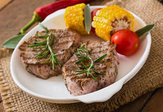 Tender and juicy veal steak. Medium rare with vegetables Royalty Free Stock Image