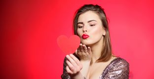 Tender kiss from lovely girl with makeup red lips. Spread romantic mood around. Sweet kiss. Air kiss. Love you so much. Woman attractive kiss face send love to stock photography