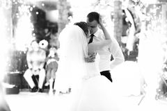 A tender kiss of newlyweds in the lights of fireworks Stock Photography