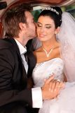 Tender kiss on wedding-day. Groom kissing bride fondly on wedding-day Stock Photo